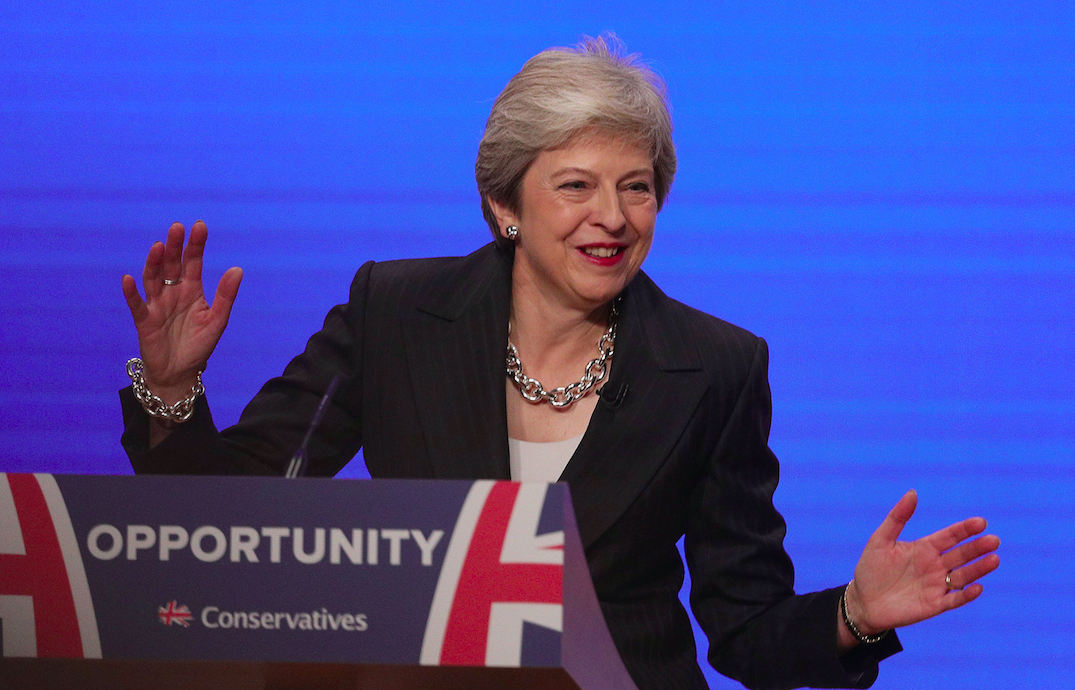 Theresa May dances to 'Dancing Queen' to open her conference speech