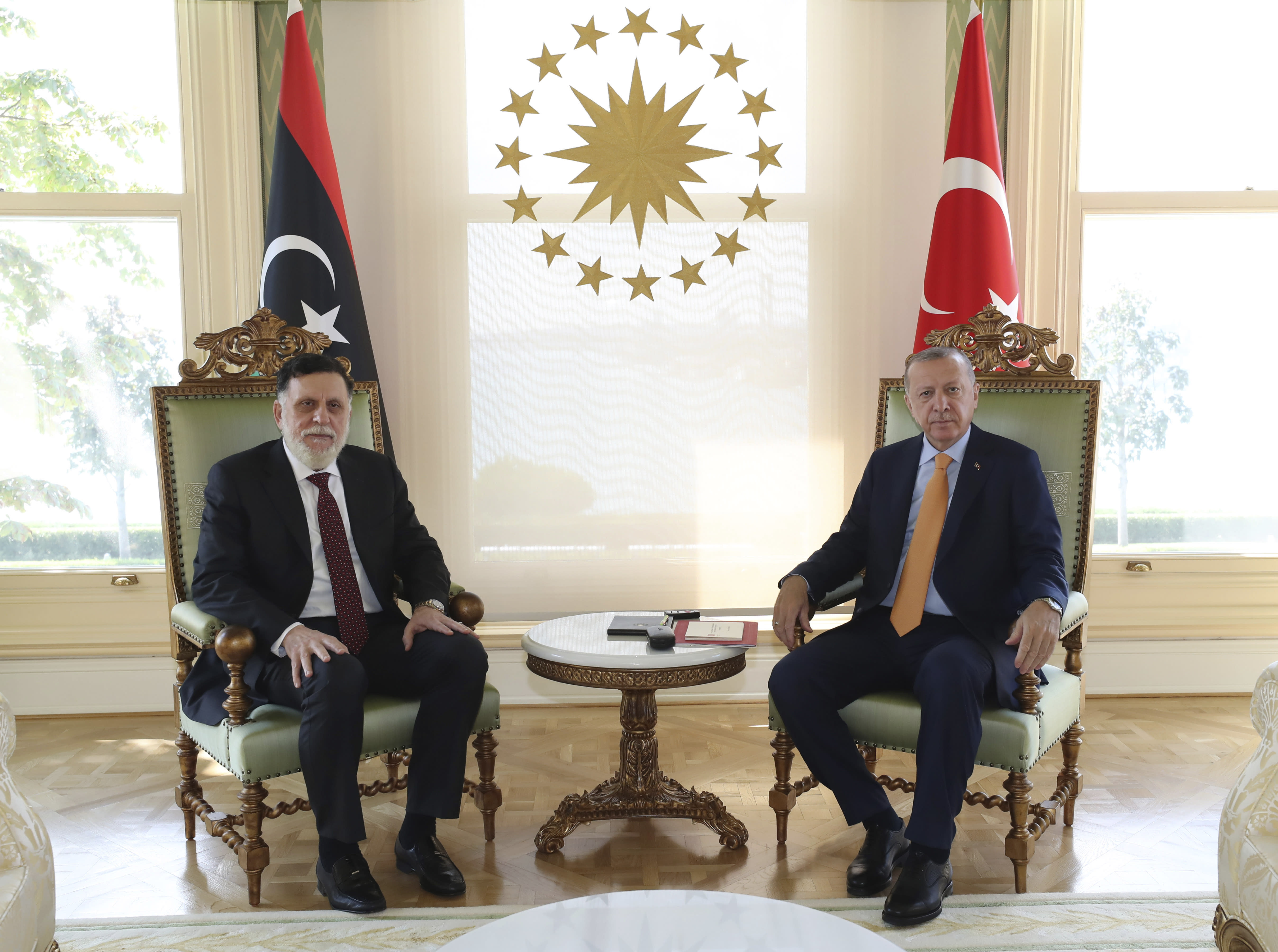 Turkey's President Recep Tayyip Erdogan, right, and Fayez Sarraj, the head of Libya's internationally-recognized government, pose together for photographs prior to their official talks in Istanbul, Sunday, Sept. 6, 2020.(Turkish Presidency via AP. Pool)