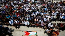 Hundreds gather for funeral of Palestinian shot by Israeli troops