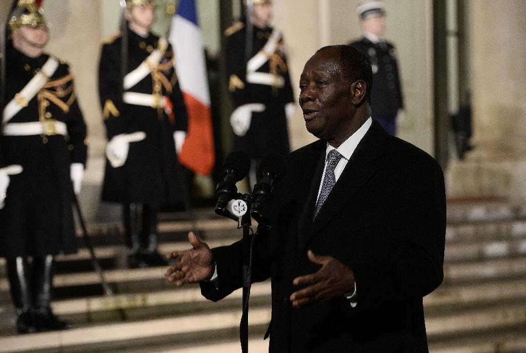 Ivory Coast's President Alassane Ouattara makes a statement following his meeting with the French President on February 4, 2016 at the Elysee Presidential Palace in Paris
