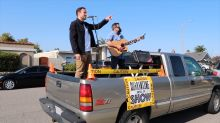 Musician stages drive-up concerts, performs in back of pickup truck to bring joy during pandemic