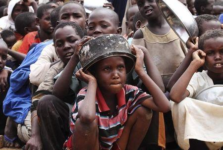 Internally displaced children queue for food supplies at the Badbado refugee camp in the south of capital Mogadishu