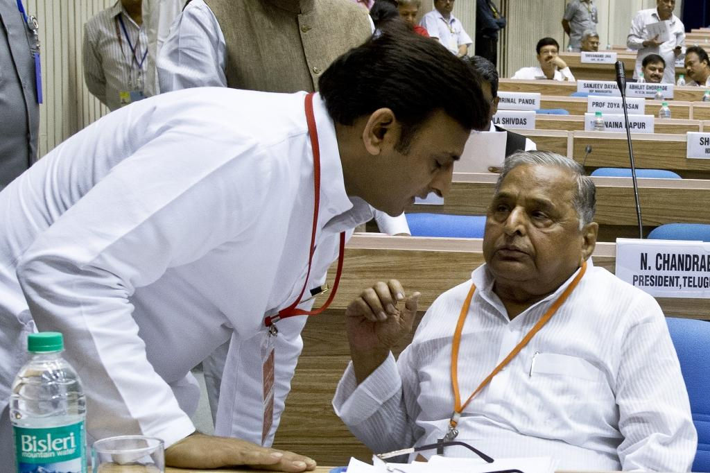 Mulayam Singh Yadav (R) petitioned India's election commission to claim the ruling party's name and bicycle symbol, after being toppled as party president by his 43-year-old son, Akhilesh Yadav (L) (AFP Photo/Prakash Singh)
