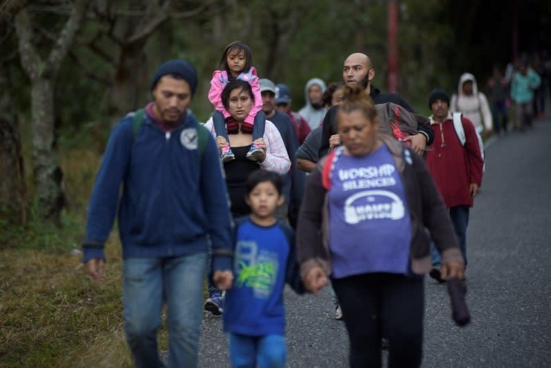 Hondurans take part in a caravan of migrants heading toward the U.S., in Chiquimula