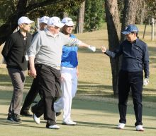 Trump, Abe to burnish ties over golf, sumo and steak
