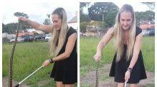 Woman catches giant python in stilettos and a mini-dress