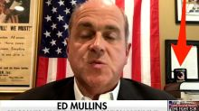 NYPD sergeants union chief Ed Mullins appears on Fox News with a QAnon mug behind him