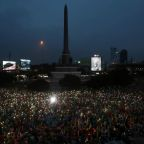 Thai police probe media, as thousands again defy protest ban