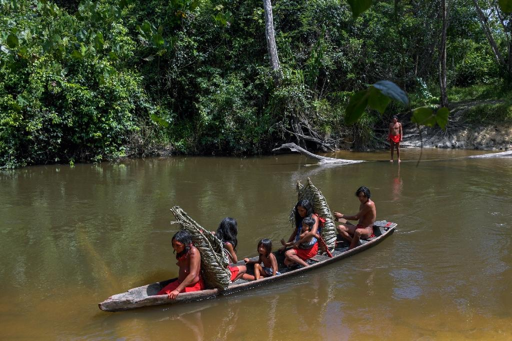 From Amazon rainforests to the Arctic Circle, indigenous peoples are under siege. Waiapi people cross the Feliz river by barge in Amapa state, Brazil (AFP Photo/Apu Gomes)
