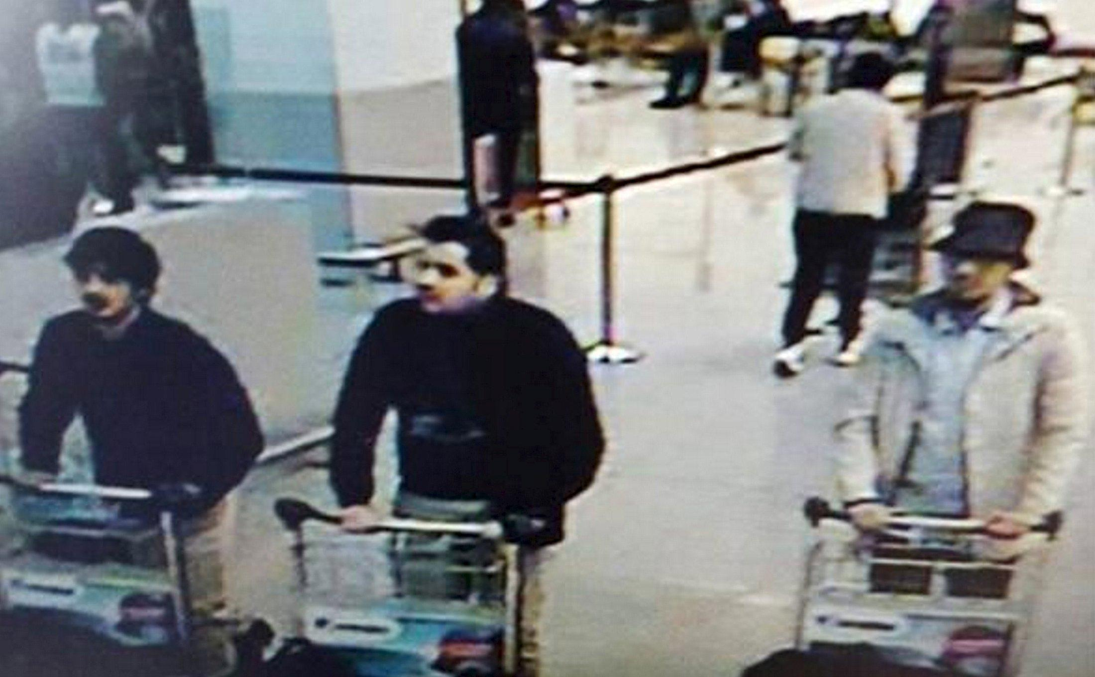 """This CCTV image from the Brussels Airport surveillance cameras made available by Belgian Police, shows what officials believe may be suspects in the Brussels airport attack on March 22, 2016. The Belgian state prosecutor said in a press conference on Tuesday, that a photograph of three male suspects was taken at Zaventem. """"Two of them seem to have committed suicide attacks. The third, wearing a light-coloured jacket and a hat, is actively being sought,"""" the prosecutor said. REUTERS/CCTV/Handout via ReutersATTENTION EDITORS - THIS PICTURE WAS PROVIDED BY A THIRD PARTY. REUTERS IS UNABLE TO INDEPENDENTLY VERIFY THE AUTHENTICITY, CONTENT, LOCATION OR DATE OF THIS IMAGE. EDITORIAL USE ONLY. NOT FOR SALE FOR MARKETING OR ADVERTISING CAMPAIGNS. NO RESALES. NO ARCHIVE. THIS PICTURE IS DISTRIBUTED EXACTLY AS RECEIVED BY REUTERS, AS A SERVICE TO CLIENTS TPX IMAGES OF THE DAY"""