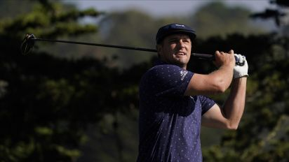 Cracked up: Driver snaps, but DeChambeau powers through