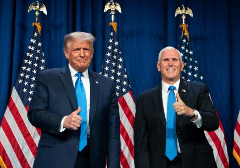 US President Donald Trump and Vice President Mike Pence attend the first day of the Republican National Convention in Charlotte, North Carolina