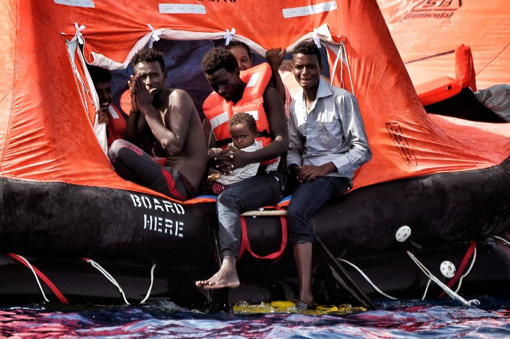Migrants wait to be rescued as they drift in the Mediterranean Sea some 20 nautical miles north off the coast of Libya on October 3, 2016 (AFP Photo/Aris Messinis)