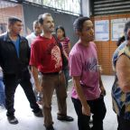 The Latest: Venezuela polling stations being kept open late