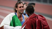 Olympic high jumpers overcome with emotion after sharing gold medal