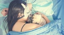 New Study Says Women Sleep Better with a Dog in the Bed