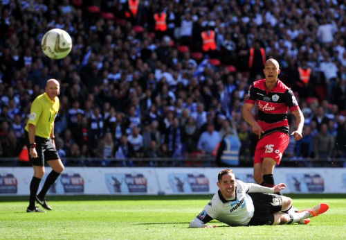 QPR's English striker Bobby Zamora scores the winning goal during the English Championship play-off final between Derby County and Queens Park Rangers at Wembley Stadium in London on May 24, 2014