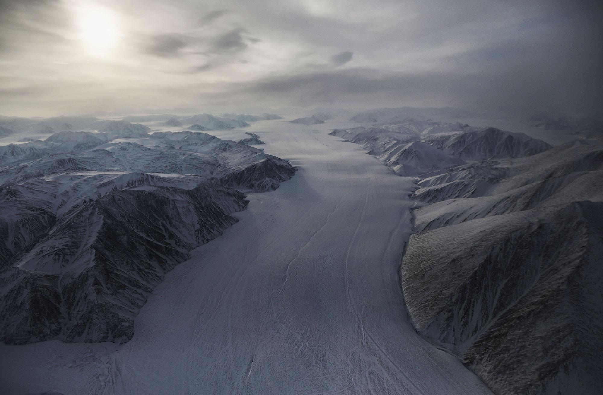 <p>A section of a glacier is seen from NASA's Operation IceBridge research aircraft on March 29, 2017 above Ellesmere Island, Canada. The ice fields of Ellesmere Island are retreating due to warming temperatures. NASA's Operation IceBridge has been studying how polar ice has evolved over the past nine years and is currently flying a set of eight-hour research flights over ice sheets and the Arctic Ocean to monitor Arctic ice loss aboard a retrofitted 1966 Lockheed P-3 aircraft. According to NASA scientists and the National Snow and Ice Data Center (NSIDC), sea ice in the Arctic appears to have reached its lowest maximum wintertime extent ever recorded on March 7.Scientists have said the Arctic has been one of the regions hardest hit by climate change. (Mario Tama/Getty Images) </p>