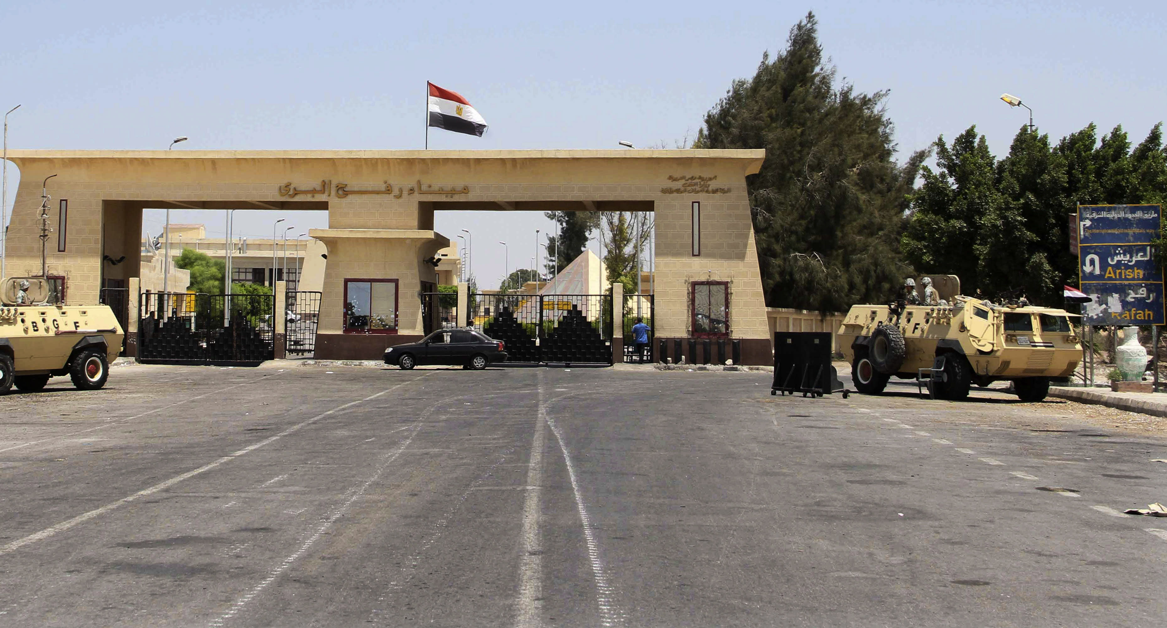 FILE - In this Monday Aug. 6, 2012 file photograph, the Rafah border terminal between Egypt and Gaza, and the only gateway for Gaza's people, is closed and guarded by Egyptian border guards in Rafah, Egypt. President Mohammed Morsi is using former jihadists to mediate with radical Islamists in Sinai, trying to ensure a halt in militant attacks in return for a stop in a military offensive in the lawless peninsula, participants in the talks say. (AP Photo/Ahmed Gomaa, File)