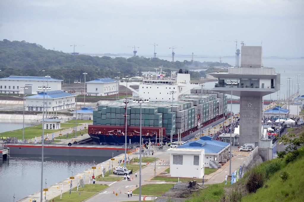 Chinese-chartered ship Cosco Shipping Panama crosses the new Agua Clara Locks during the inauguration of the expansion of the Panama Canal in Colon on June 26, 2016 (AFP Photo/Johan Ordonez)
