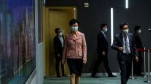 Hong Kong leader postpones policy speech after Beijing summons