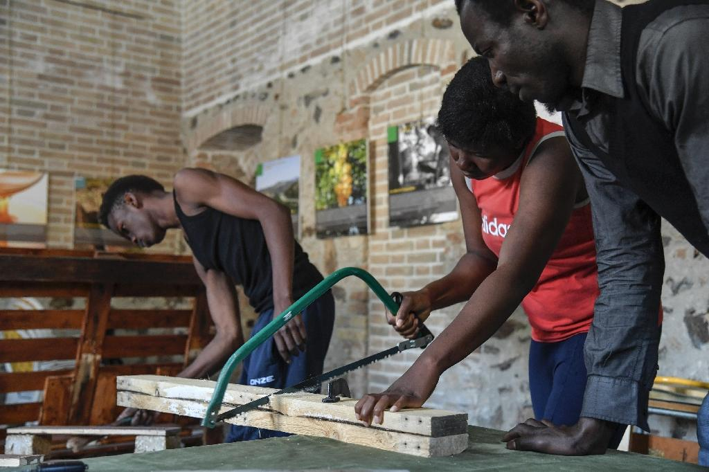 Migrants from African countries attend a lesson of carpentry in Sant' Alessio in Aspromonte, a small village of 330 inhabitants in Calabria, southern Italy (AFP Photo/Andreas Solaro)