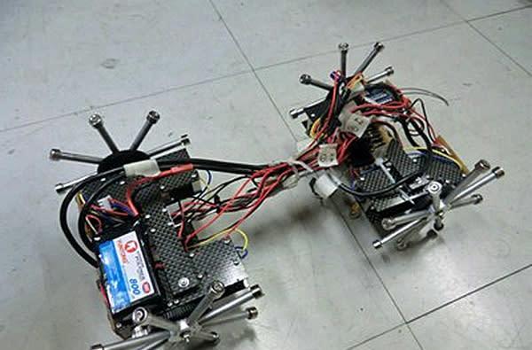 Japanese bridge inspection robot has magnetic wheels, shuffles up walls