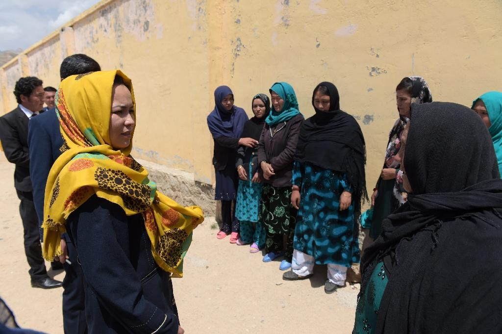 Daikundi governor Masooma Muradi (L) spoke to prisoners at a female detention centre in Nili, the province's capital, in May 2016 (AFP Photo/Shah Marai)