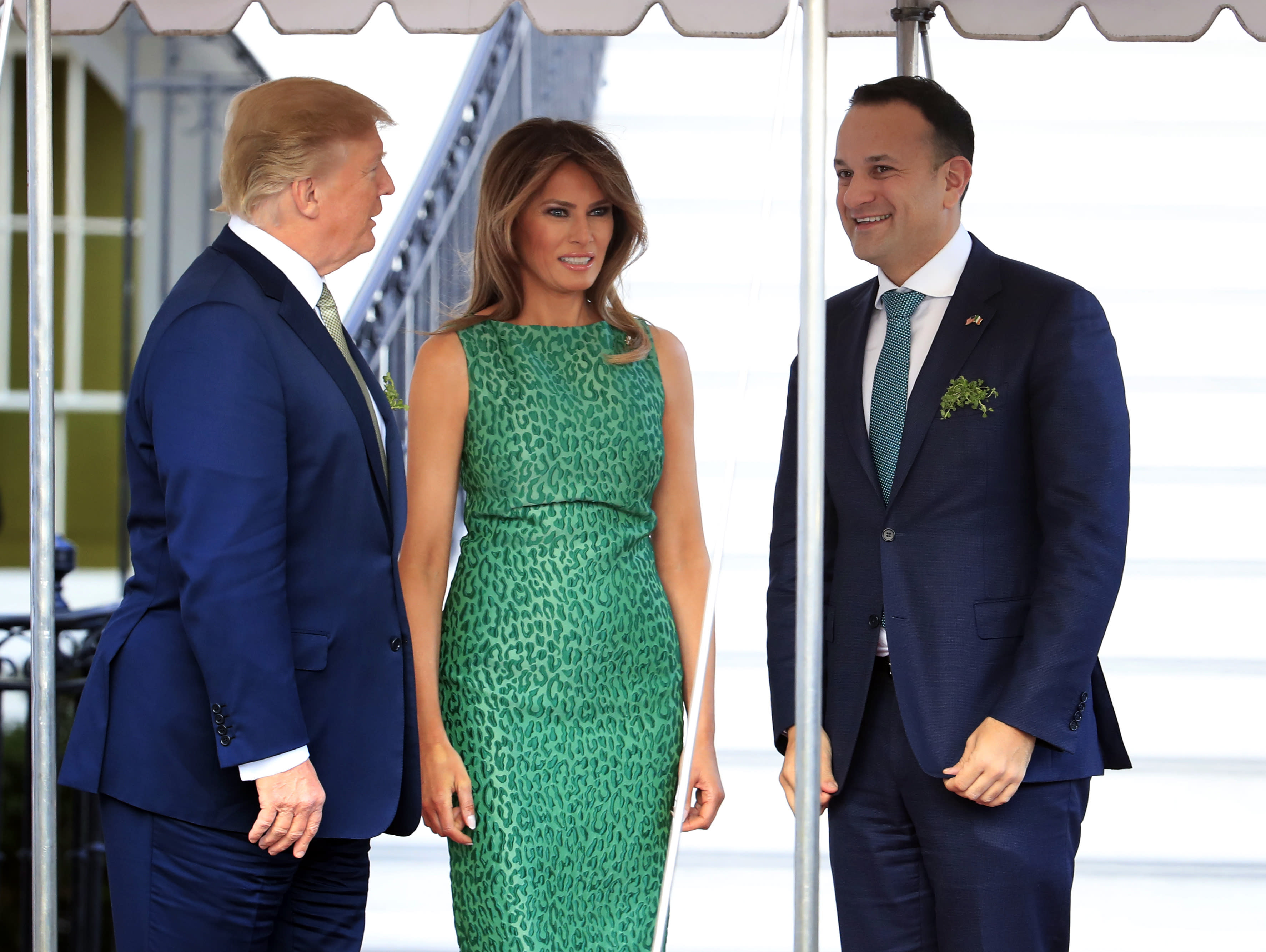 b075476fe68c Melania Trump wears green cocktail dress by a designer beloved by Lady Gaga  — and by Michelle Obama
