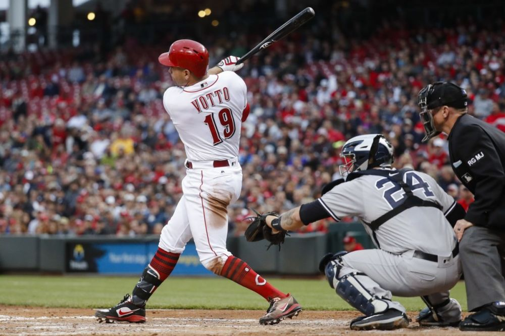 The Cincinnati Reds' Joey Votto has a great eye, but his abundance of walks comes at a price for fantasy owners. (AP Photo/John Minchillo)