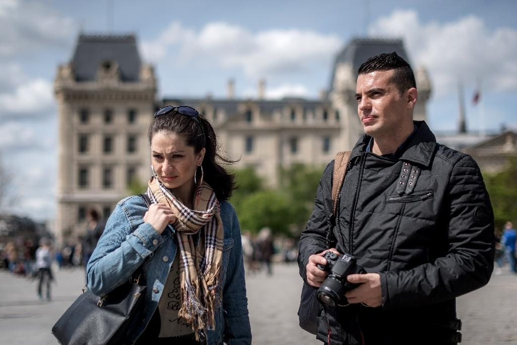 Afghan actress Marina Golbahari and her husband Noor pose for a picture in Paris on April 14, 2016 (AFP Photo/Philippe Lopez)