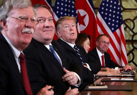FILE PHOTO: U.S. President Donald Trump, U.S. Secretary of State Mike Pompeo, White House national security adviser John Bolton and acting White House Chief of Staff Mick Mulvaney attend the extended bilateral meeting in the Metropole hotel with North Korea's leader Kim Jong Un and his delegation during the second North Korea-U.S. summit in Hanoi, Vietnam February 28, 2019. REUTERS/Leah Millis/File Photo
