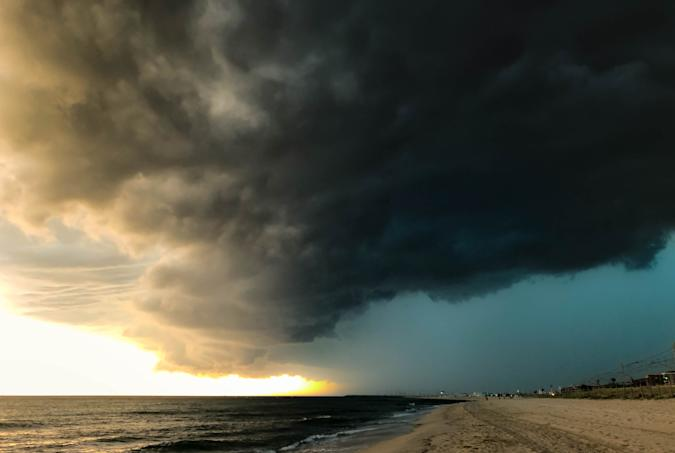 Supercell storm during summer in the Barcelona coastline moving forward like a wave with heavy rain and thunderstorm.