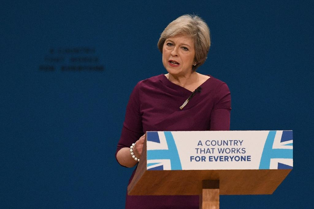 British Prime Minister Theresa May addresses the Conservative Party conference in Birmingham, central England, on October 5, 2016 (AFP Photo/Paul Ellis)