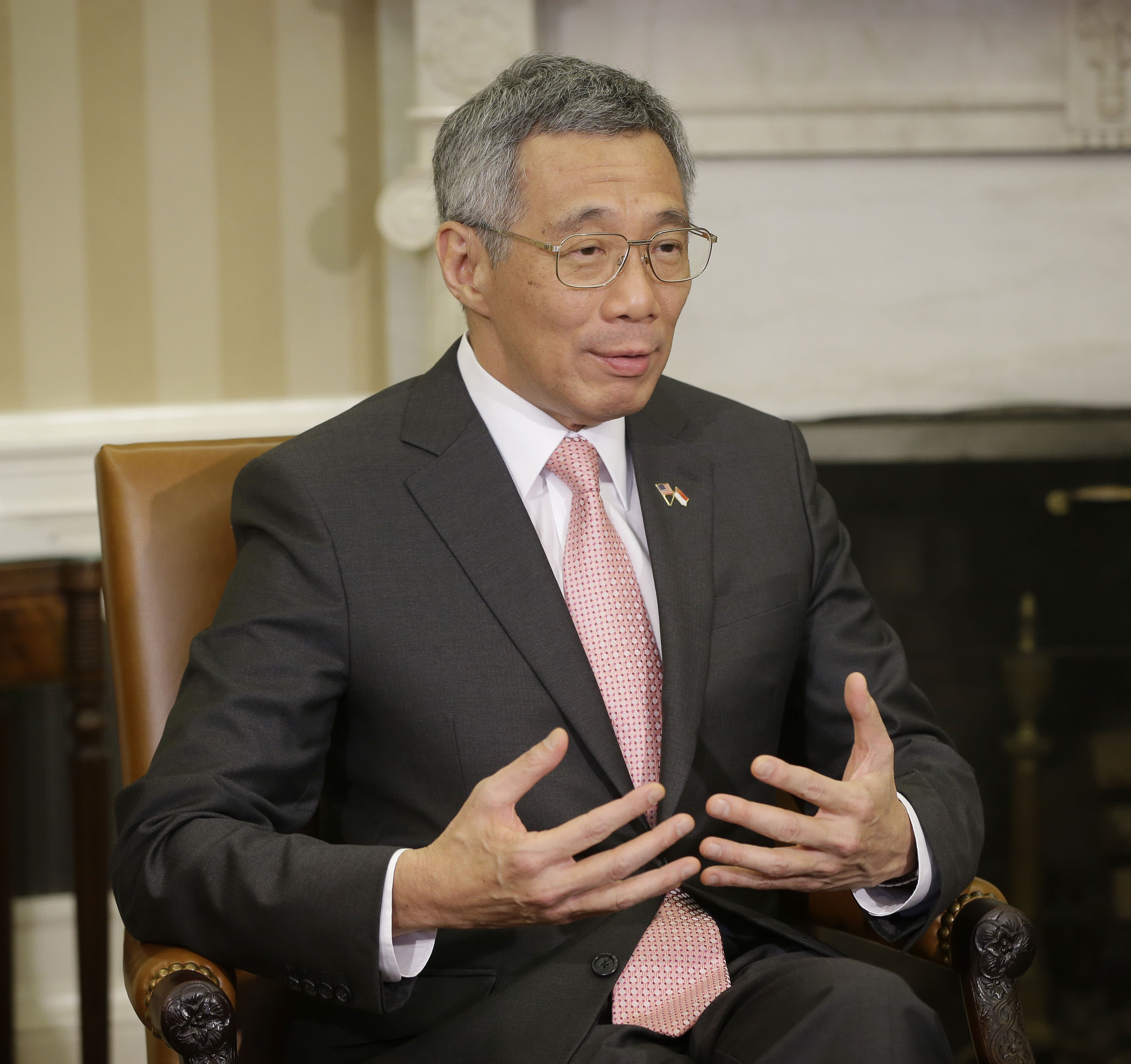 Singapore Prime Minister Lee Hsien Loong gestures during his meeting with President Barack Obama in the Oval Office of the White House in Washington, Tuesday, April, 2, 2013. (AP Photo/Pablo Martinez Monsivais)
