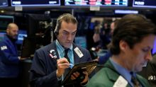 Stocks end modestly lower after Fed hikes rates; energy up