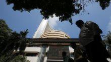 Sensex, Nifty settle higher on trade reprieve; financials boost