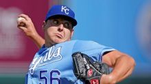 Keller dominant, holds Reds hitless into 6th, KC wins opener