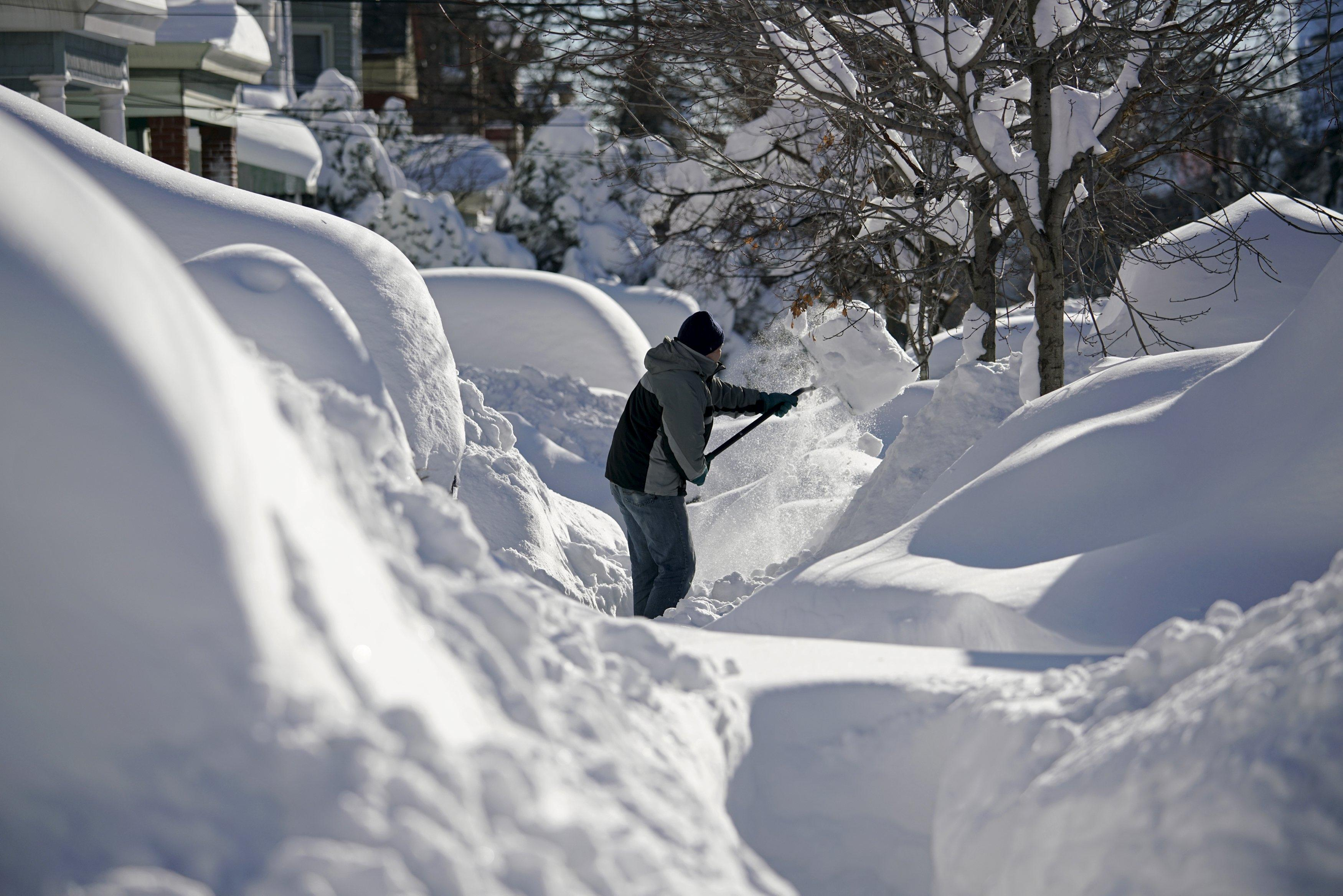 A resident shovels snow away from the entrance to his home in Union City, New Jersey, across the Hudson River from Midtown Manhattan, after the second-biggest winter storm in New York history, January 24, 2016. REUTERS/Rickey Rogers TPX IMAGES OF THE DAY