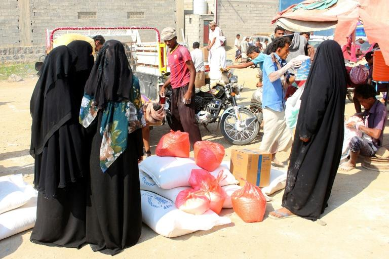 Humanitarian agencies describe a deteriorating situation in the Huthi-controlled north where aid workers face arrest and intimidation as they attempt to distribute food to millions in dire need (AFP Photo/ESSA AHMED)