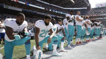 APNewsBreak: Dolphins anthem punishment includes suspensions