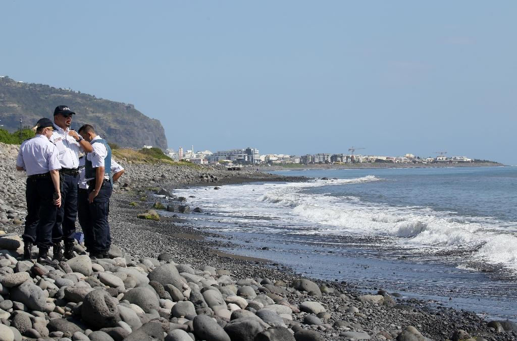 Several pieces of debris found on a beach on La Reunion island on August 2, 2015 sparked excitement as one was believed by locals to be from a plane door (AFP Photo/Richard Bouhet)