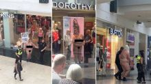 Plus-size woman stands naked in shop window to protest skinny mannequins