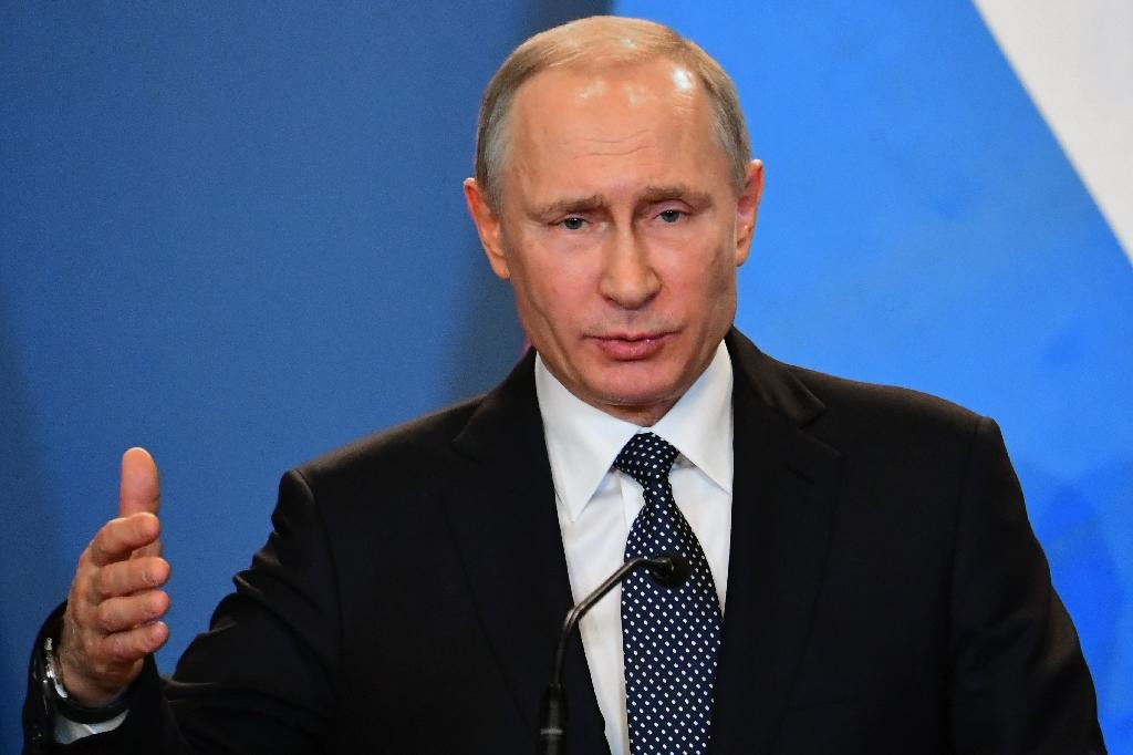 russias putin signs easing penalty domestic violence