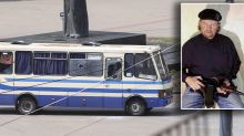 Man armed with guns, explosives holding at least 10 hostages on bus