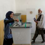 Long queues as Afghan voters defy election day attacks, delays