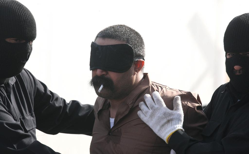 A Saudi man smokes his last cigarette before being hanged for the murder of a compatriot just west of the capital Kuwait City, on April 1, 2013