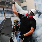 Hong Kong protests descended into violence over surveillance concerns on the movement's 12th weekend