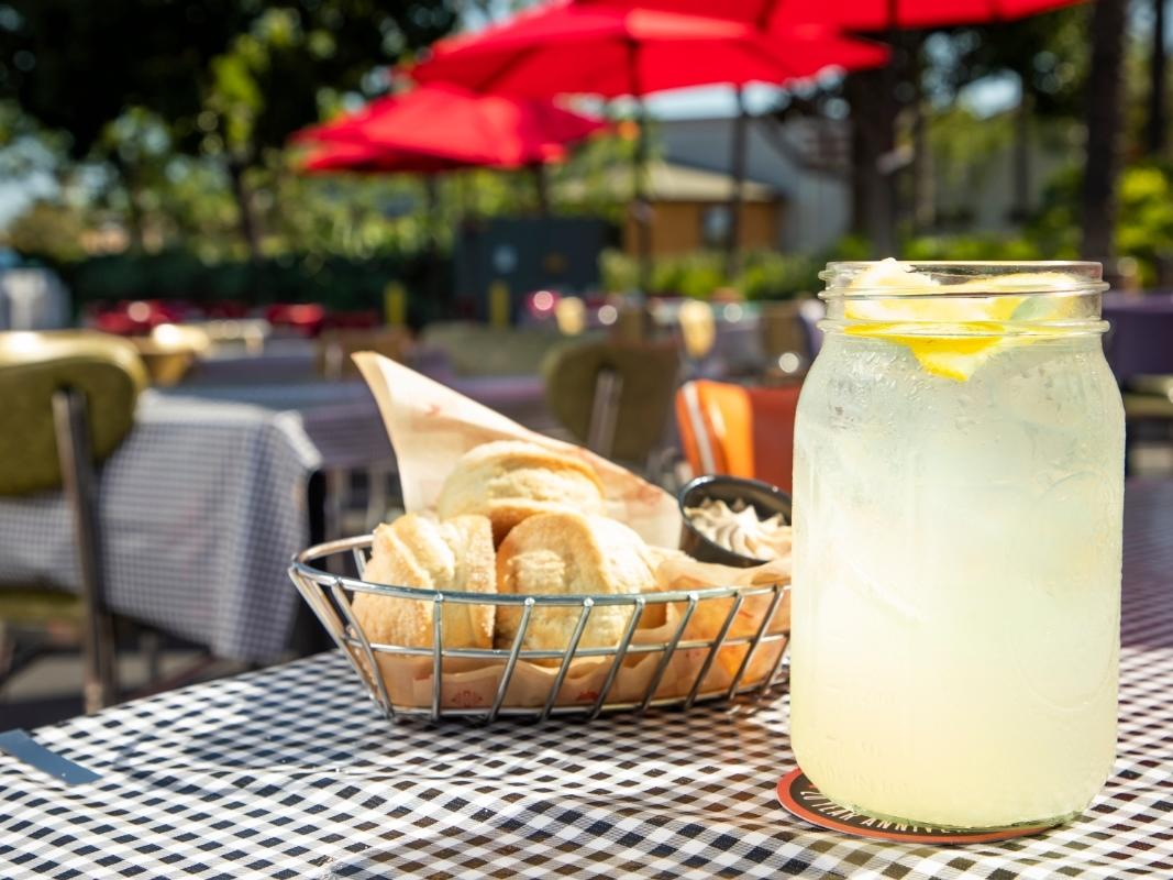 """Enjoy a welcoming """"Sweet Sips & Biscuits"""" freebie at Lucille's Smokehouse Bar-B-Que during summer 2020."""