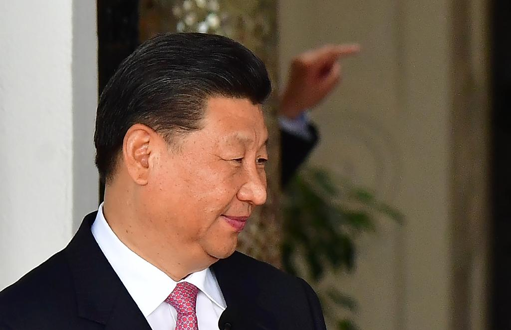 Xi stressed the importance of China's relationship with Portugal as part of a broader network of trade links stretching across Asia, Africa and Europe (AFP Photo/Luis ACOSTA)
